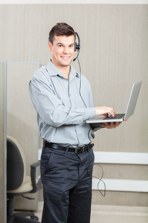 customer service representative: Male Customer Service Representative With Laptop Stock Photo