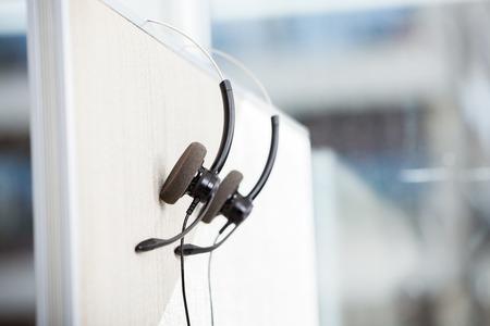 business  call: Headphones Hanging In Empty Office