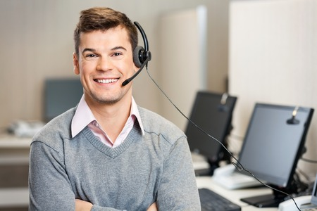 Customer Service Representative With Headset In Call Center