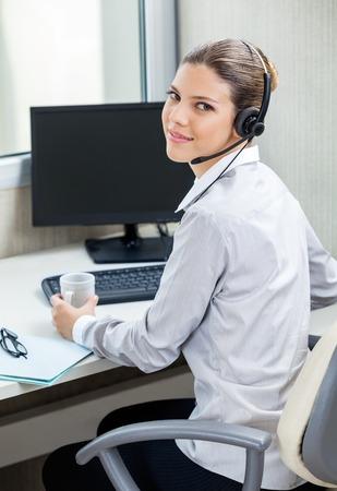 service desk: Customer Service Agent At Computer Desk