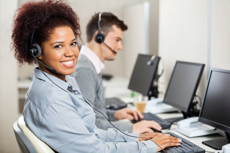 service desk: Customer Service Representatives Working In Office