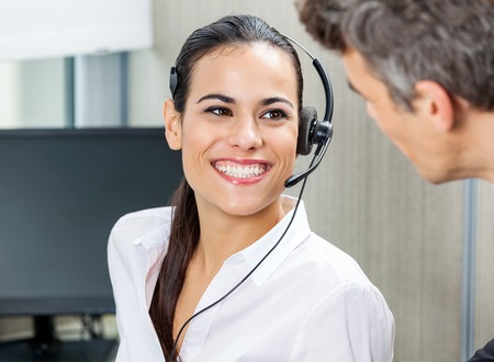 happy customer: Happy Customer Service Representative Looking At Manager