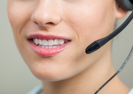 Closeup Of Smiling Customer Service Representative With Headset photo