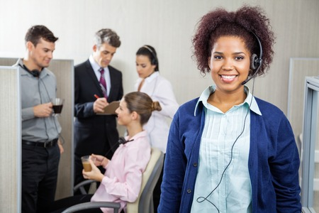 Happy Female Customer Service Representative Wearing Headphones photo