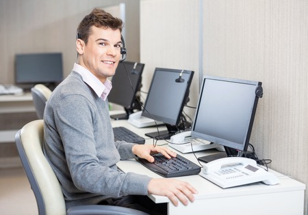 cubicle: Customer Service Representative Working In Office Stock Photo