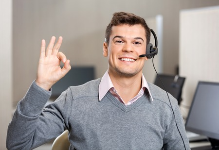 happy customer: Customer Service Representative Showing Ok Sign