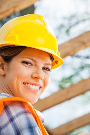 female construction worker: Happy Female Construction Worker At Site