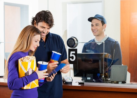 Couple Buying Movie Tickets At Box Office Stock Photo - 37193673