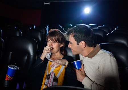 horror movies: Man Consoling Woman Crying While Watching Movie