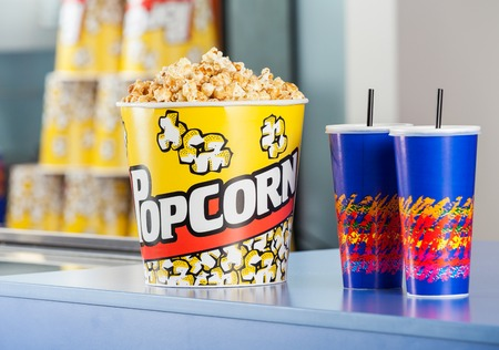 concession: Popcorn Bucket With Drinks On Concession Counter Stock Photo