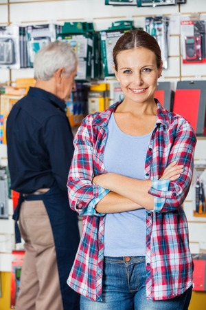 Customer With Arms Crossed In Hardware Store photo