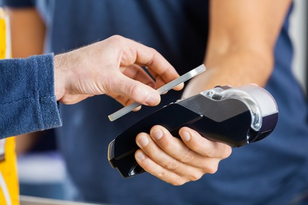 wireless terminals: Man Paying Through NFC Technology At Cinema