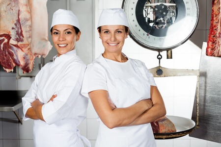 Female Butchers Standing Arms Crossed photo