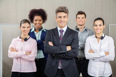 manager team: Confident Manager And Team Standing At Call Center