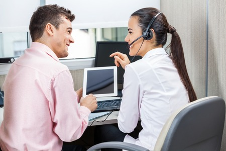 Call Center Representatives Using Tablet Computer