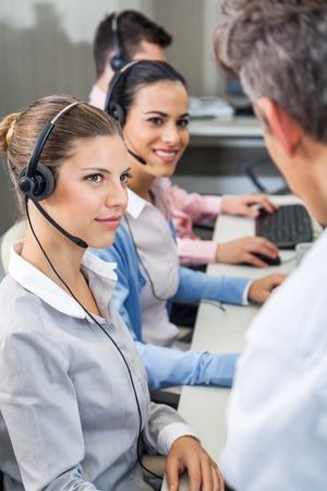 head set: Customer Service Executives Looking At Manager