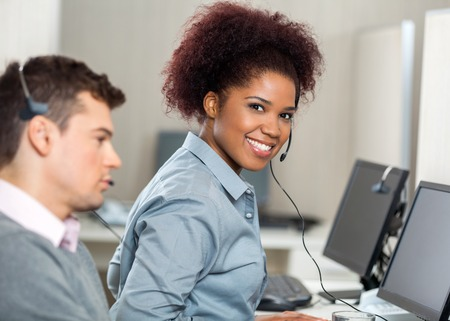 head set: Young Customer Service Representative In Office Stock Photo
