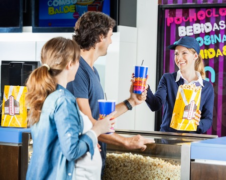 Worker Selling Snacks To Man At Cinema Concession Stand Stock Photo ...