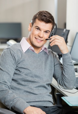 representatives: Customer Service Representative Working In Office Stock Photo