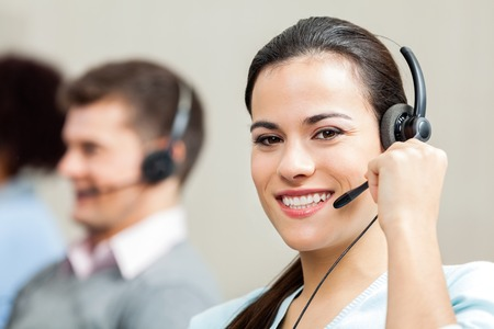 contact center: Portrait Of Confident Female Customer Service Executive