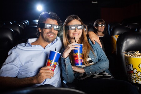 3d: Happy Couple Watching 3D Film In Theater