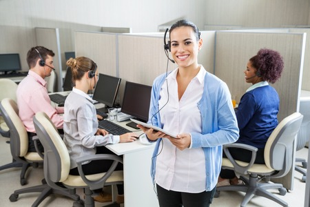 Happy Customer Service Representative Holding Tablet Computer Stock Photo