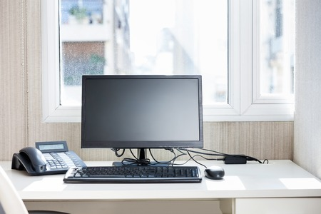 Komputer stacjonarny Telefon Na I Biurko Zdjęcie Seryjne