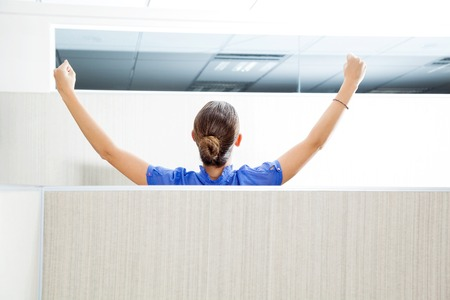 cubicle: Customer Service Representative With Arms Raised In Cubicle