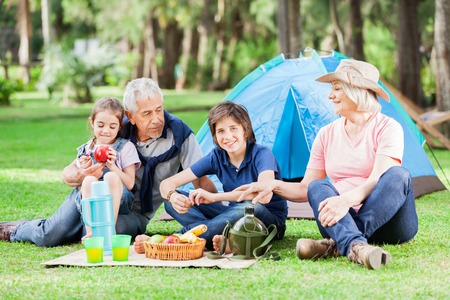 Multi Generation Family Camping In Park photo