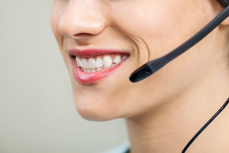 head set: Smiling Female Customer Service Agent Wearing Headset Stock Photo