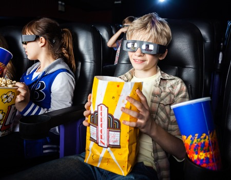 3d: Boy Having Snacks While Watching 3D Movie With Sister
