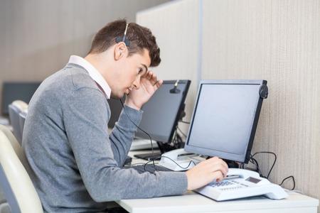 Tensed Customer Service Representative At Desk photo