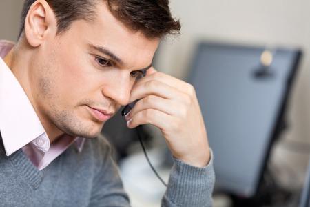 customer service representative: Serious Customer Service Representative In Office