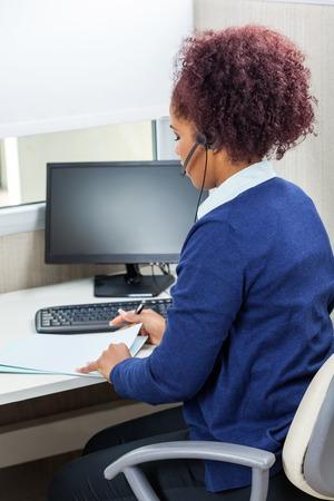Customer Service Executive Analyzing Documents photo