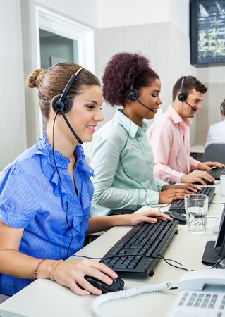 Customer Service Representatives Using Computers In Call Center