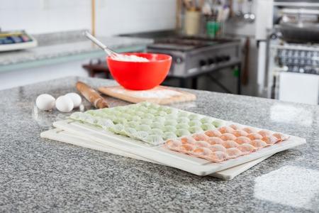 unprepared: Unprepared Ravioli Pasta At Counter In Commercial Kitchen