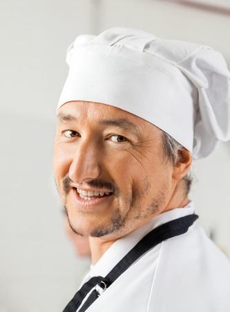 toque blanche: Closeup Portrait Of Happy Male Chef Stock Photo