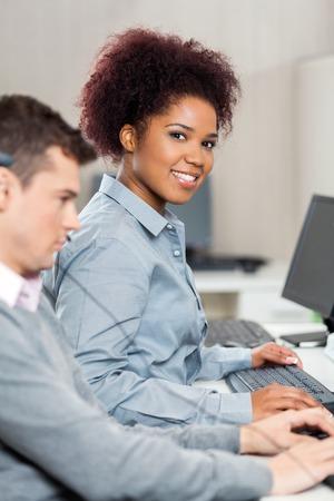 callcenter: Beautiful Customer Service Representative Working In Office