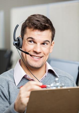 customer service representative: Customer Service Representative With Clipboard Looking Away Stock Photo
