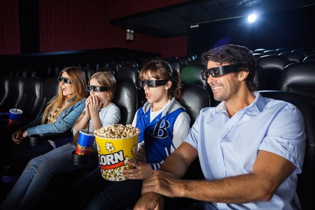 3d: Family Watching 3D Movie In Cinema Theater Stock Photo