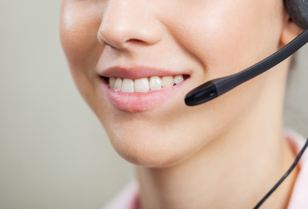 customer service representative: Smiling Female Customer Service Representative Stock Photo