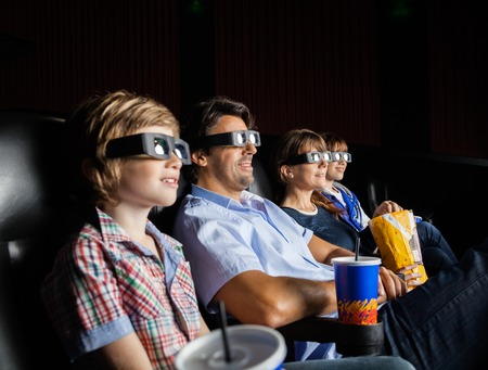 3d: Family Watching 3D Movie In Theater