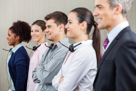 Smiling Customer Service Representative Standing With Colleagues photo