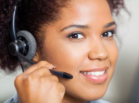 call center agent: Smiling Female Customer Service Representative Wearing Headset