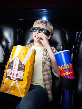 eating popcorn: Boy Eating Popcorn In 3D Movie Theater