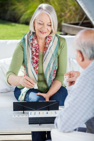 Happy Senior Woman Playing Rummy Con Man photo