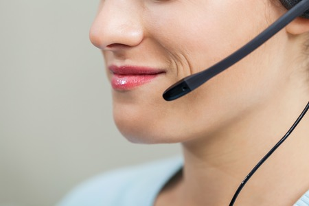 Female Call Center Employee Using Mic In Office photo