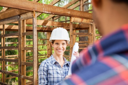 Happy Architect Looking At Colleague On Construction Site photo