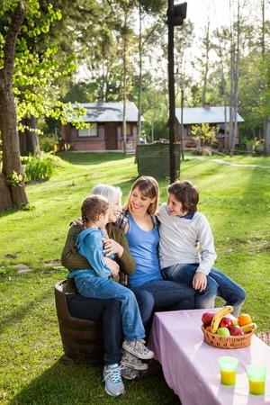 multi generation: Happy Multi Generation Family At Campsite