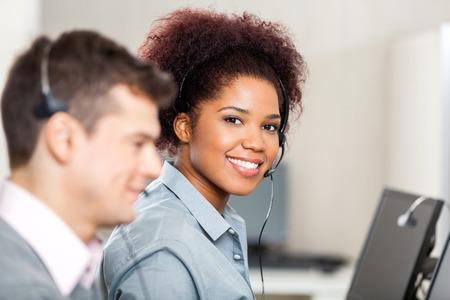 Customer Service Representative Working In Office Stock Photo